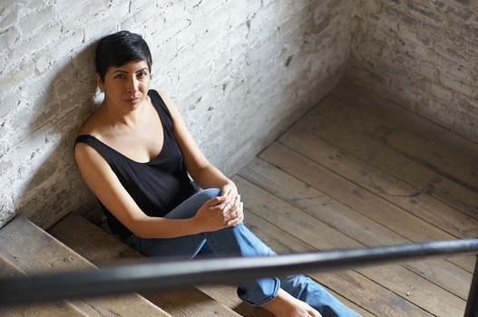 Aditi Brennan Kapil on the stairs