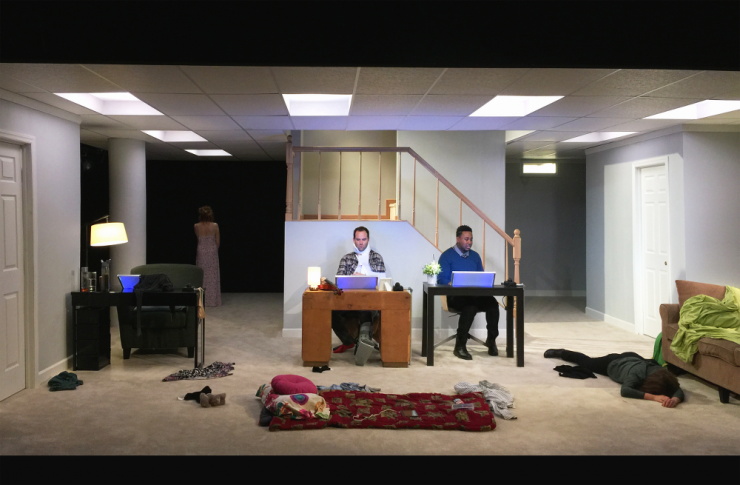 two actors in a living room on stage