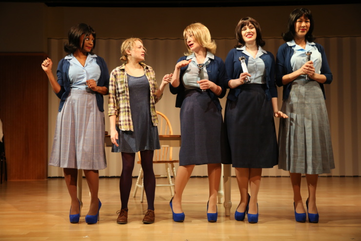 four actresses gossiping on stage