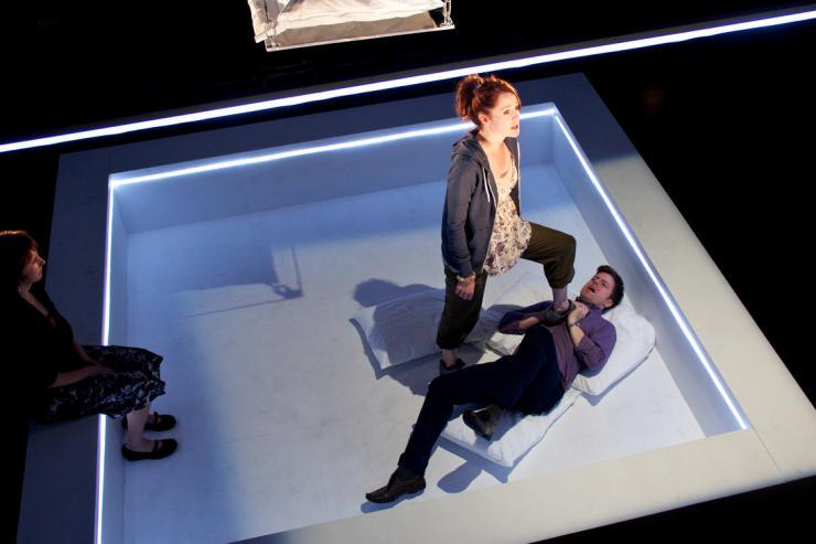 three actors on stage