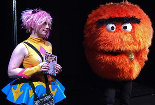Actor on stage with puppet.