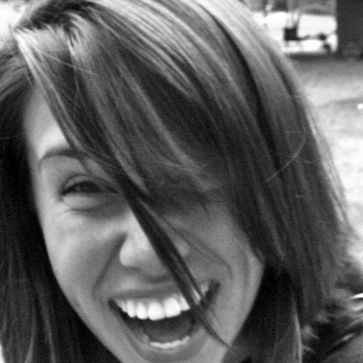 a woman laughing at the camera