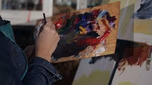 Artist with paint on palette