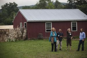 Four people outside a barn at Double Edge