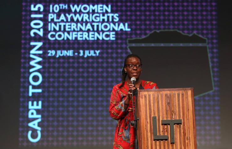 a woman giving a speech at a podium