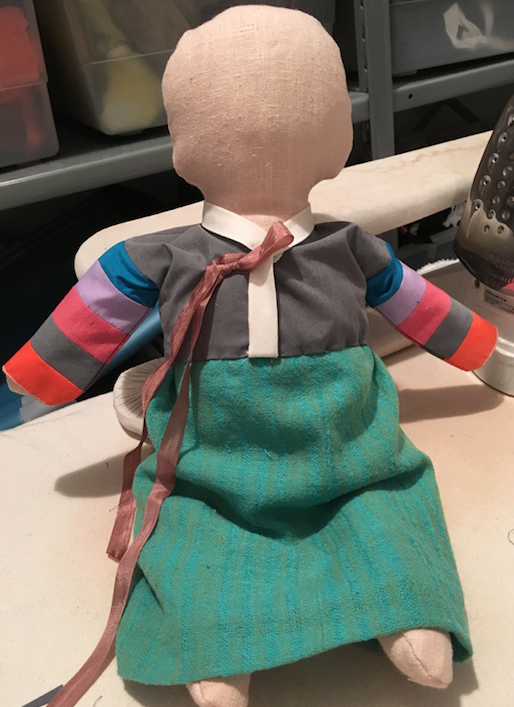 an unfinished prop doll