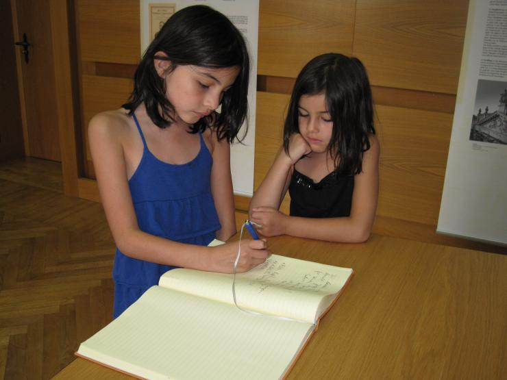 two young girls writing