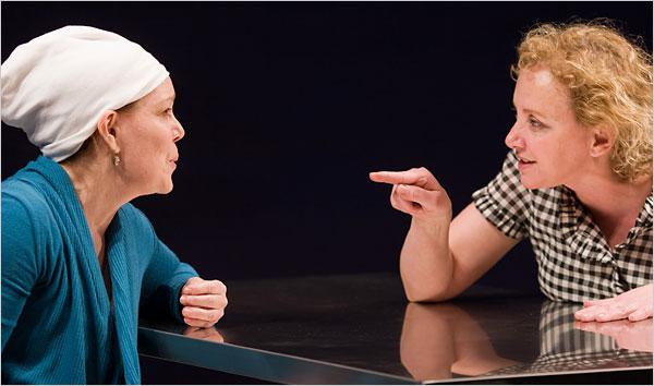 two actresses arguing at a table