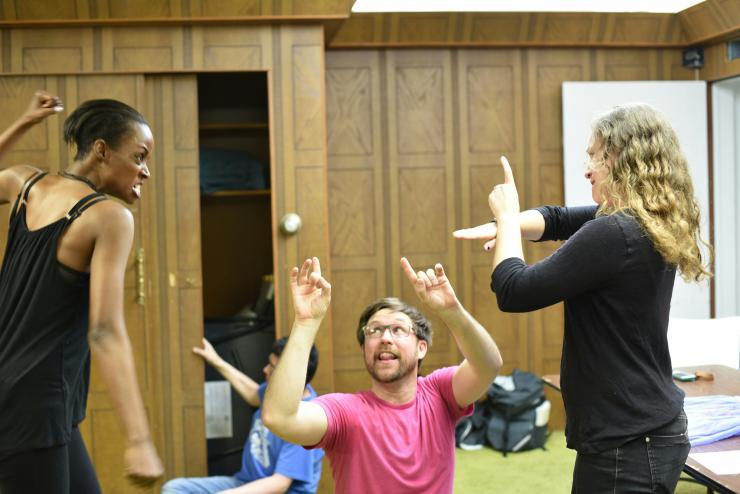 three actors using sign language