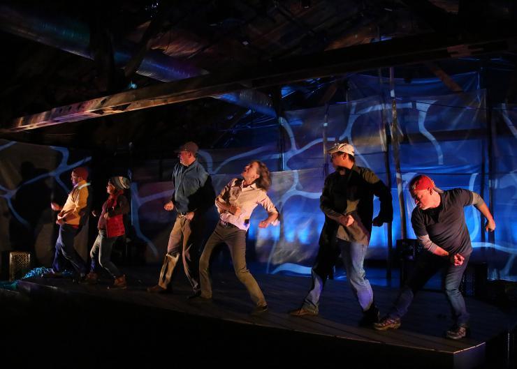actors dancing in a line