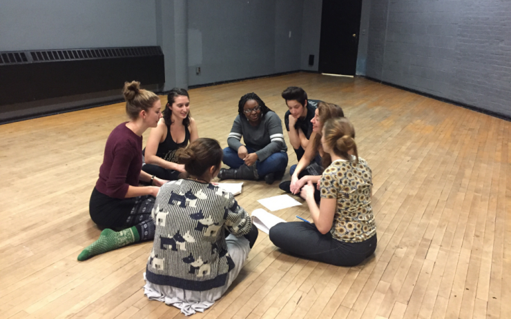 actors discussing a work in rehearsal