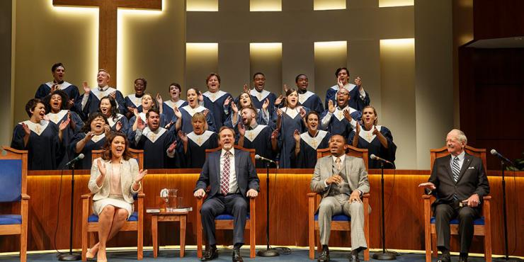 a choir singing on stage