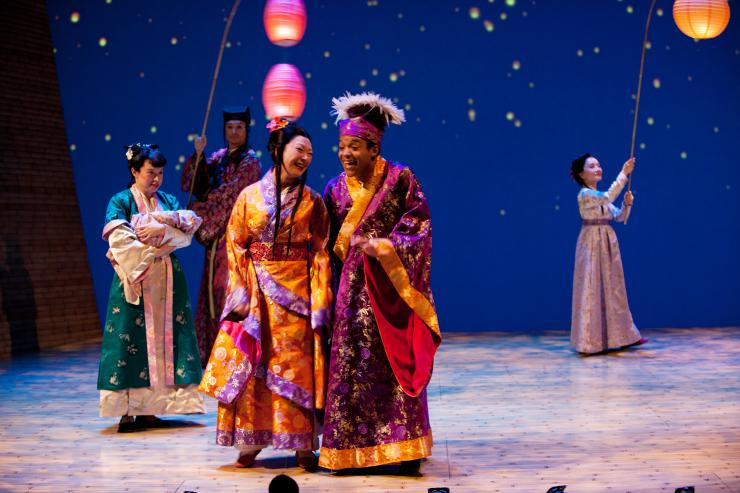 a group of women in kimonos on stage