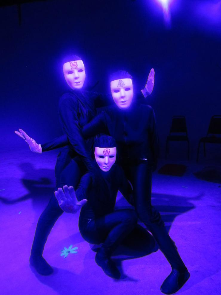 three actors in masks