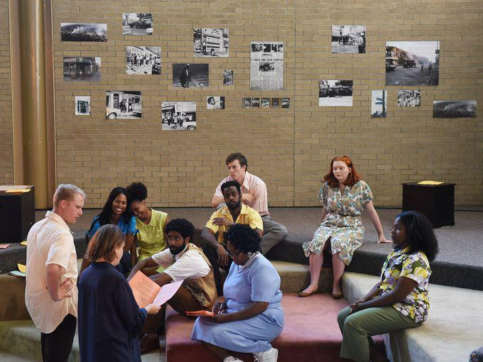 The cast listens to director Kristin Horton's notes.