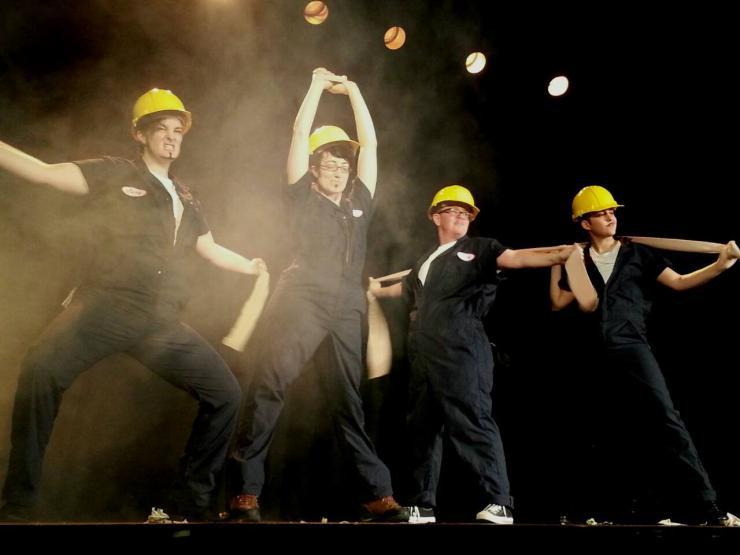 group of men dancing in costume