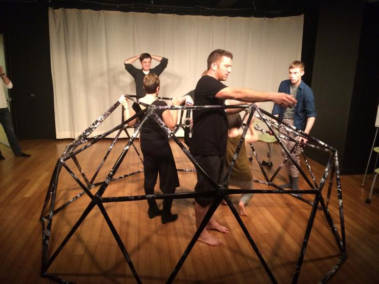 Actors building a geodesic dome