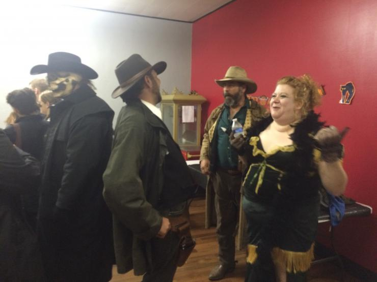 actors in costume laughing