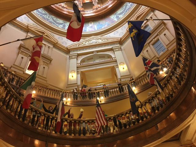 State house rotunda with people chanting