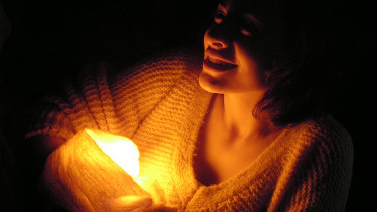 an actress holding a light