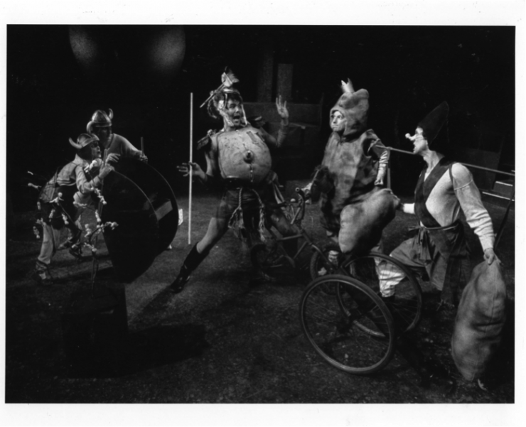 Actors on stage with armor and bicycles