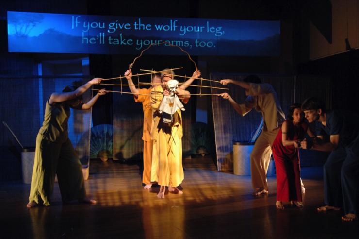 Actors operating a puppet