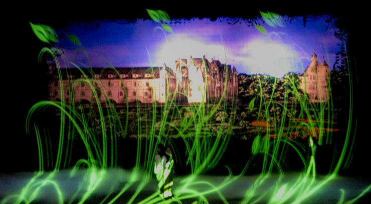 medi design of grass and cityscape on stage