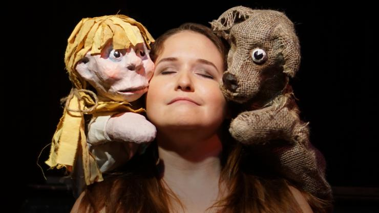a woman posing with puppets