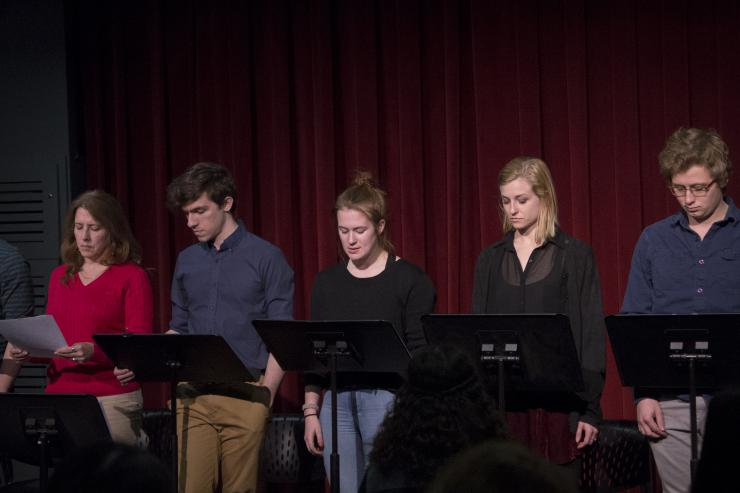 a group of actors at a staged reading