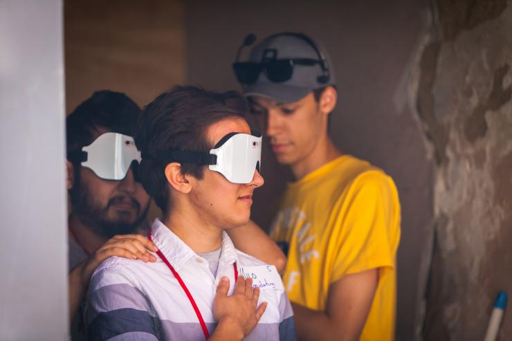 a group of people with VR goggles up