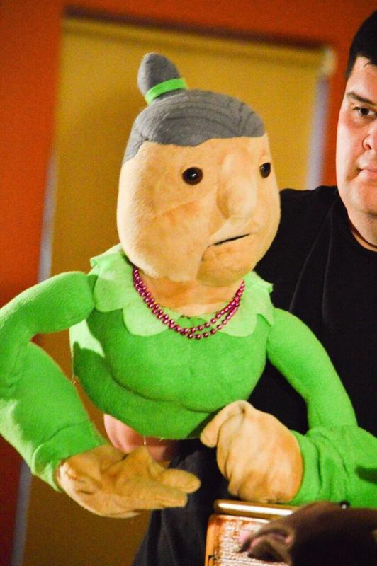 man holding puppet