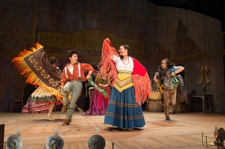 actors dance onstage
