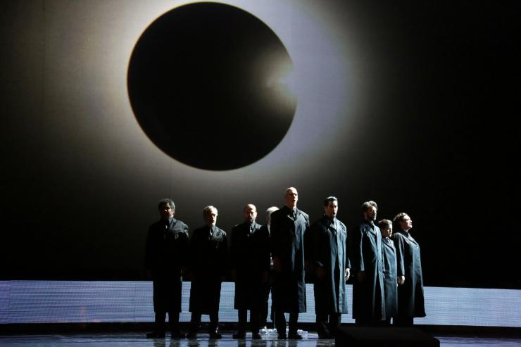 a group of actors in black robes
