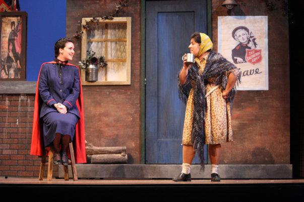 two actresses talking on stage