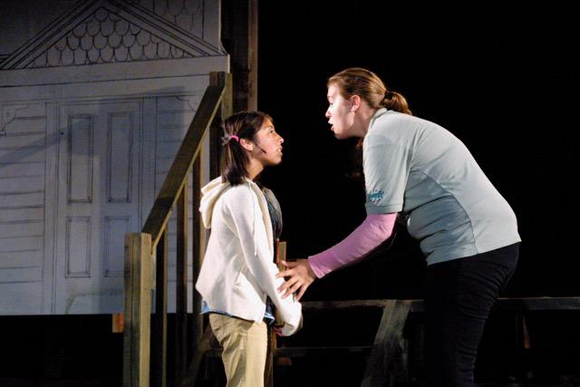 an actress and a child on stage
