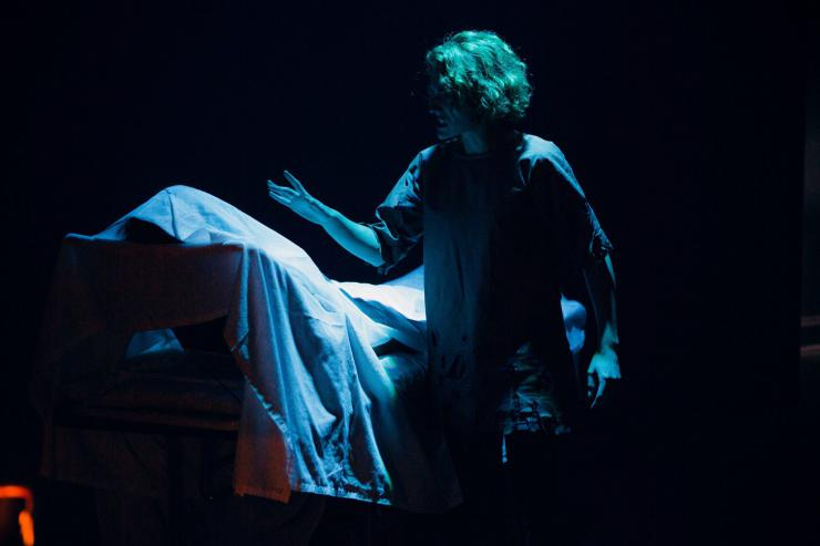 actor on a dark stage