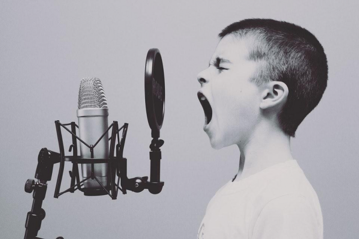 a child yelling into a mic