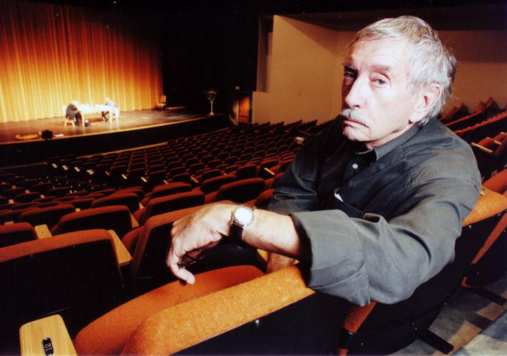 director/teacher sitting in a theater