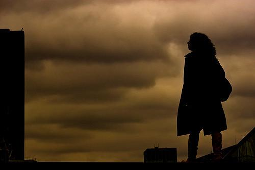 a silhouette against a cloudy sky