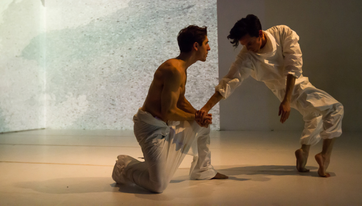 two actors in white on stage