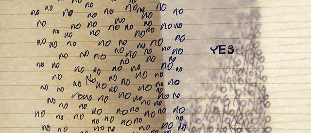 a page crowded with handwritten yes and no