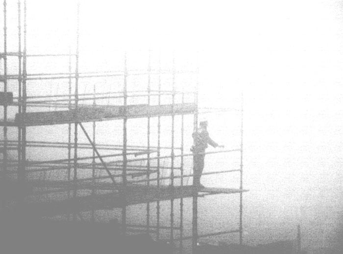 vintage photo of a man on scaffolding