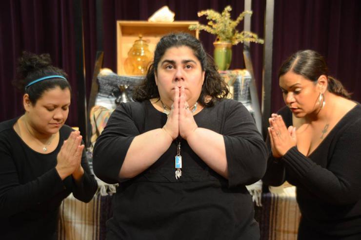 three actresses praying on stage
