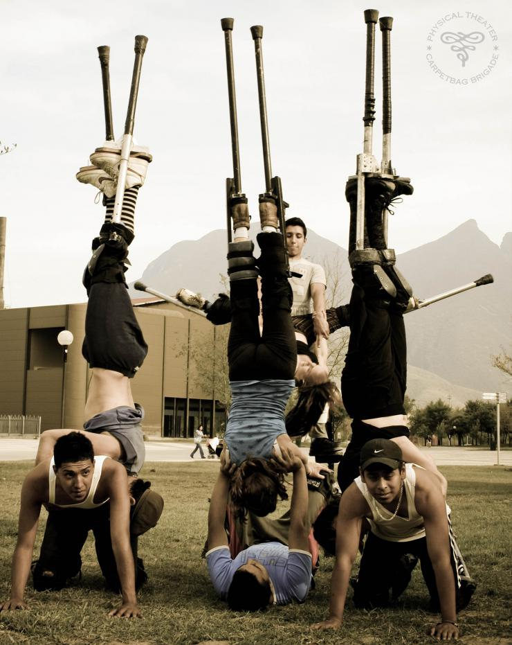 acrobats in a stunt on stilts
