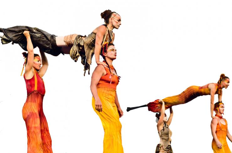 acrobats in a stunt in stilts