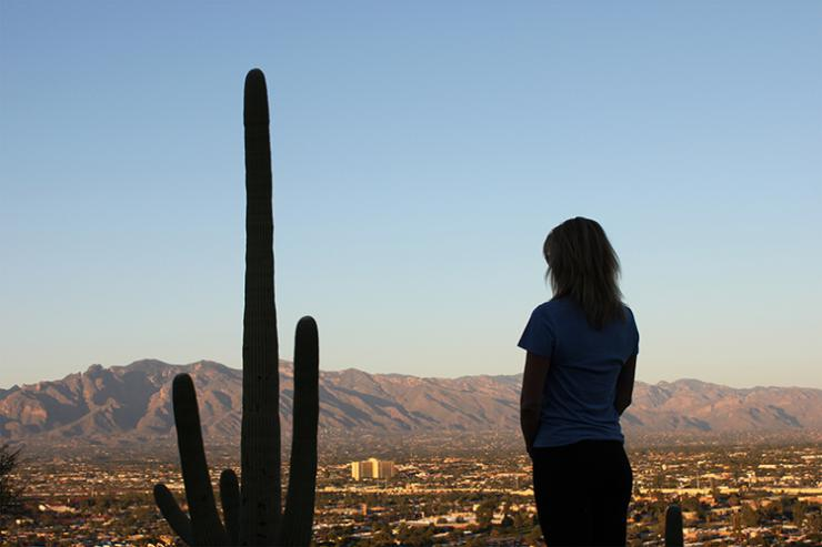 woman facing a cactus