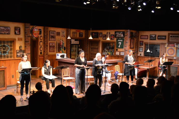 a group of actors in a staged reading