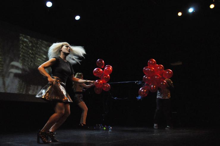 Actors on stage with balloons