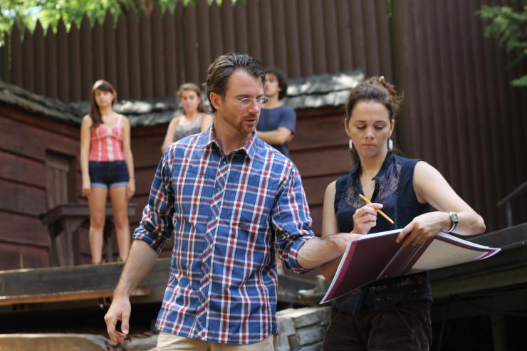 Two people going over a script outdoors