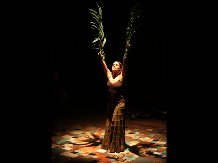 an actress performing with leaves
